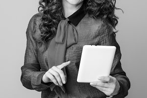 happy young woman on background using tablet PC