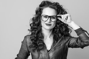 happy modern woman in glasses against background
