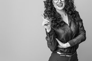 smiling modern woman in glasses got idea isolated on