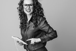 happy woman in headphones isolated on using tablet PC