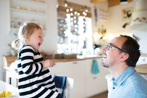 Little girl with her father having fun, lauging. Christmas seaso
