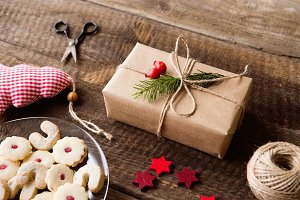 Beautifully wrapped Christmas presents, studio shot, wooden back