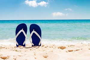 Flip flops on tropical sand beach