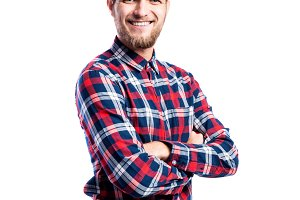 Hipster man in jeans and shirt, studio shot, isolated