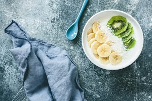 Yogurt with banana, kiwi and coconut