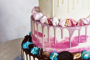 Three-tiered colored cake with color