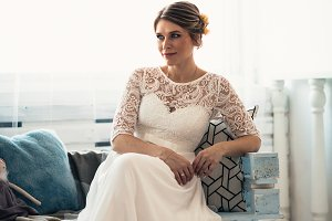 portrait of a bride near a window studio