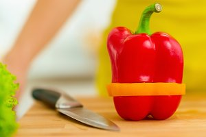 Closeup on red bell pepper with yellow slice