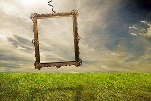 Empty retro frame under grassy land