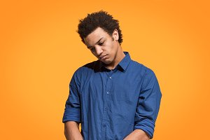 Beautiful bored man bored isolated on orange background