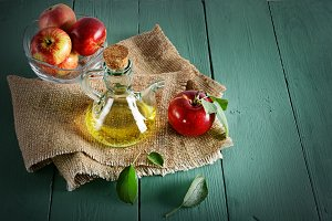 apple cider vinegar on wooden table