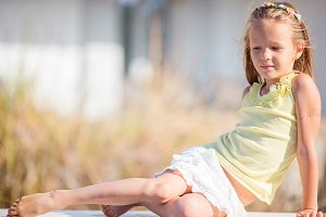 Portrait of adorable little girl in yoga outdoor on vacation