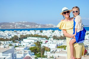 Happy mother and little adorable girl in Mykonos during summer greek vacation