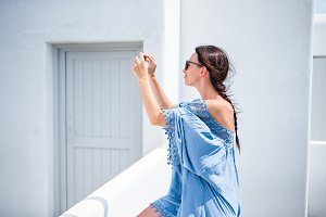 Young beautiful woman taking selfie with phone outdoors during vacation