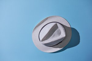 gray male hat isolated on blue background