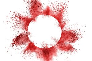 red powder explosion behind a round frame exploding on white background