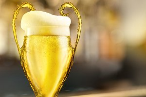 Football cup made of beer with foam as a symbol of the UEFA Champions League