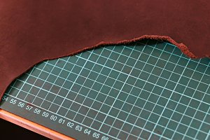 Piece of leather on cutting mat