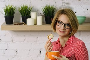 Girl drinks tea with biscuits