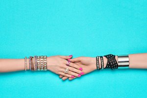 Fashion. Female hand, Trendy Jewelry. Friendship