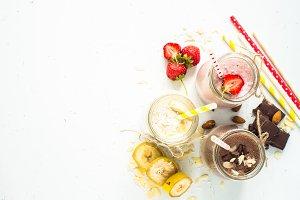 Banana chocolate and strawberry milkshakes