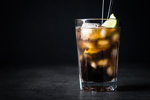 Cuba libre on dark background.