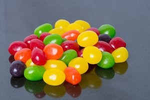 Jelly beans on black background