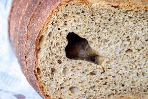 Rye bread with a large hole in the cut.