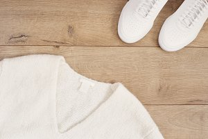 White women sweater and sneakers