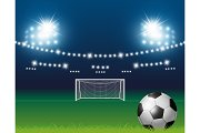 Soccer ball and goal with spotlight