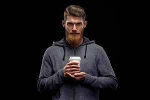 Bearded man with cup of coffee