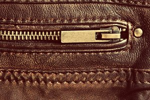 Genuine leather with zip and seam