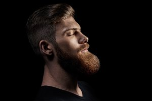 Portrait of single bearded handsome young caucasian man
