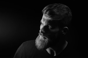 Portrait of caucasian man with big beard in black T-shirt Horizontal