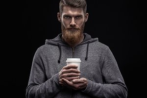 Bearded man with coffee in hand