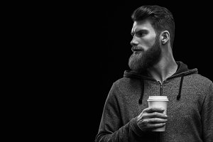 Bearded stylish man with cup of coffee