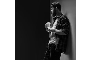 Confident perfect hairstyle man having coffee