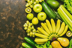 Fresh fruits and vegetables are yellow and green. Top view, copy space.