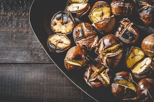 Roasted chestnuts in iron pan