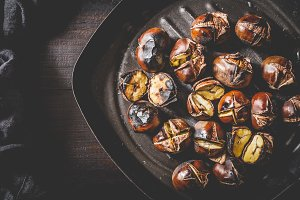 Roasted chestnuts in grilling pan.
