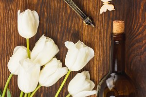 White tulips, bottle of wine and Eiffel tower