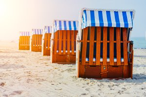 Line of beach Chairs on sandy beach on Travemuende, Luebeck Bay, Germany