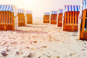 Beach Chairs on sandy beach on Travemuende, Luebeck Bay, Germany