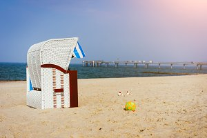 One Beach Chairs on sandy beach on Travemuende, Luebeck Bay, Germany