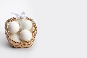 egg in basket on gray background
