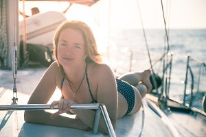 Woman on sailboat.
