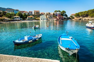 Boat in the bay in Assos village, Kefalonia island, Greece.