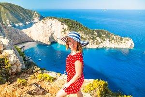 Woman traveler in Greece against Famous Navajio beach.