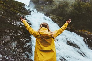 Happy woman enjoying waterfall view