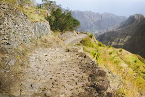 Typical trekking trail on Santo Antao, leads between huge rocks down to the Coculi valley. Cape Verde